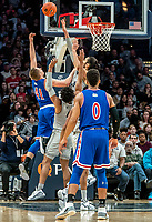 WASHINGTON, DC - DECEMBER 28: Omer Yurtseven #44 of Georgetown blocks a shot by Jacob Boonyasith #41 of American. during a game between American University and Georgetown University at Capital One Arena on December 28, 2019 in Washington, DC.