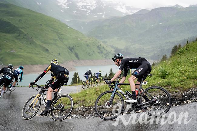 Mark Donovan (GBR/DSM) descending the Col du Pré (HC/1748m) towards the Barrage de Roselend in, yet again, grim conditions.<br /> <br /> Stage 9 from Cluses to Tignes (145km)<br /> 108th Tour de France 2021 (2.UWT)<br /> <br /> ©kramon
