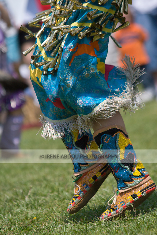The bells on this Jingle Dancer's dress jingle and sway during every twist and turn at the 8th Annual Red Wing PowWow in Virginia Beach, VA.