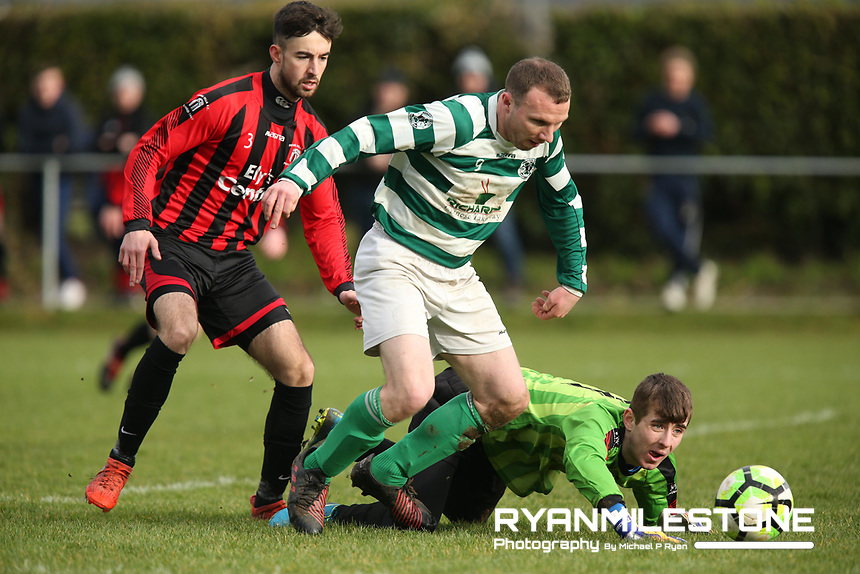 Peake Villa's Goalkeeper William Tierney in action against Nenagh Celtic's Jimmy Hynes during the Munster Junior Cup 4th Round at Tower Grounds, Thurles, Co Tipperary on Sunday 28th January 2018, Photo By: Michael P Ryan