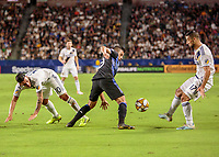 CARSON, CA - SEPTEMBER 21: Cristian Pavon #10 and Sebastian Lletget #17 of the Los Angeles Galaxy battle with Saphir Taïder #8 of the Montreal Impact for a loose ball during a game between Montreal Impact and Los Angeles Galaxy at Dignity Health Sports Park on September 21, 2019 in Carson, California.