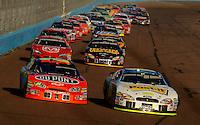 Nov 13, 2005; Phoenix, Ariz, USA;  Nascar Nextel Cup drivers Jeff Gordon and Greg Biffle lead the field on a restart during the Checker Auto Parts 500 at Phoenix International Raceway. Mandatory Credit: Photo By Mark J. Rebilas