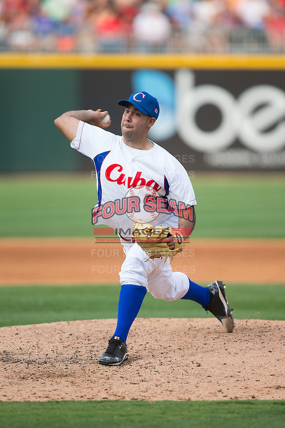 Cuban National Team starting pitcher Ismel Jimenez Santiago (23) in action against the US Collegiate National Team at BB&T BallPark on July 4, 2015 in Charlotte, North Carolina.  The United State Collegiate National Team defeated the Cuban National Team 11-1.  (Brian Westerholt/Four Seam Images)