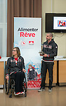 Sochi, RUSSIA - Mar 9 2014 -  Sonja Gaudet receives the James Worrall Flag Bearer Award next to Benoit Huot at the Petro-Canada Sochi 2014 Family & Friends reception at Canada Paralympic House at the 2014 Paralympic Winter Games in Sochi, Russia.  (Photo: Matthew Murnaghan/Canadian Paralympic Committee)