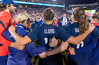 FRISCO, TX - MARCH 11: Carli Lloyd #10 of the United States stands in the huddle during a game between Japan and USWNT at Toyota Stadium on March 11, 2020 in Frisco, Texas.