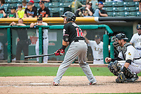 Jose Rivera (12) of the Albuquerque Isotopes at bat against the Salt Lake Bees in Pacific Coast League action at Smith's Ballpark on June 8, 2015 in Salt Lake City, Utah.  (Stephen Smith/Four Seam Images)