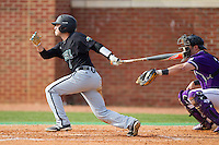 Michael Paez (1) of the Coastal Carolina Chanticleers follows through on his swing against the High Point Panthers at Willard Stadium on March 15, 2014 in High Point, North Carolina.  The Chanticleers defeated the Panthers 1-0 in the first game of a double-header.  (Brian Westerholt/Four Seam Images)