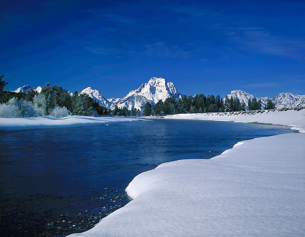 Mount Moran and the Snake River in winter, Grand Teton National Park, Jackson, Wyoming, USA. .  John leads private photo tours throughout Colorado. Year-round Colorado photo tours. John offers private photo tours in Grand Teton National Park and throughout Wyoming and Colorado. Year-round.