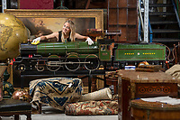BNPS.co.uk (01202 558833)<br /> Pic: PhilYeomans/BNPS<br /> <br /> Francesca Whitham from Dreweatts with the incredibly detailed locomotive.<br /> <br /> Mini marvel - exact scale model of legendary Great Western steam train is chuffing into auction.<br /> <br /> A remarkably detailed model train which produces steam and runs like the real thing has emerged for sale for £80,000.<br /> <br /> The 9ft long, 7.25ins gauge model is a scale replica of the Great Western Railway locomotive 'King Richard I'.<br /> <br /> It has a copper boiler with its own miniature pressure gauge and is fitted with brakes, lamps and a water tank.<br /> <br /> There are removable foot rests attached and such is the attention to detail the driver has a padded seat.<br /> <br /> The locomotive was built by a Manchester based model maker who is now selling it at auction.