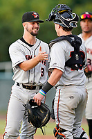 Pitcher Thomas Girard (3) of the Delmarva Shorebirds celebrates with catcher Logan Michaels (10) following a win in a game against the Lynchburg Hillcats on Wednesday, August 11, 2021, at Bank of the James Stadium in Lynchburg, Virginia. (Tom Priddy/Four Seam Images)