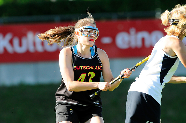 BERLIN, GERMANY - JUNE 22: Semifinal between Team Germany (black) vs LCC Radotin (white) during the Berlin Open Lacrosse Tournament 2013 at Stadion Lichterfelde on June 22, 2013 in Berlin, Germany. Final score 9-8. (Photo by Dirk Markgraf/www.265-images.com) *** Local caption *** #43 Pia Balz of Germany