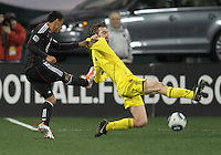 Andy Najar#14 of D.C. United shoots the ball past Eddie Gaven#12 of the Columbus Crew during the opening match of the 2011 season at RFK Stadium, in Washington D.C. on March 19 2011.D.C. United won 3-1.