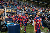 KANSAS CITY, KS - JULY 15: Cristian Roldan #10, Eryk Williamson #19 and Miles Robinson #12 of the United States make they're way out to the line up during a game between Martinique and USMNT at Children's Mercy Park on July 15, 2021 in Kansas City, Kansas.
