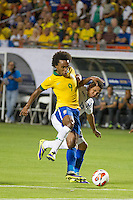 Miami, FL - Saturday, Nov 16, 2013: Brazil vs Honduras during an international friendly at Miami's Sun Life Stadium. Brazilian forward William dominates the ball at the entrance of the box.