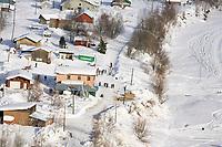 Aerial of Sled Dog Team Arriving @ Takotna Chkpt Iditarod 2005