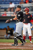 West Virginia Black Bears catcher Arden Pabst (52) signals to the infield with Aaron Knapp (5) at bat during a game against the Batavia Muckdogs on June 29, 2016 at Dwyer Stadium in Batavia, New York.  West Virginia defeated Batavia 9-4.  (Mike Janes/Four Seam Images)