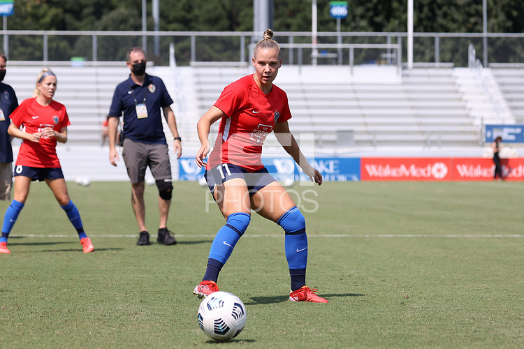 CARY, NC - SEPTEMBER 12: Merritt Mathias #11 of the North Carolina Courage warms up before a game between Portland Thorns FC and North Carolina Courage at Sahlen's Stadium at WakeMed Soccer Park on September 12, 2021 in Cary, North Carolina.