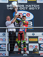Shane Byrne of Be Wiser Ducati Racing Team is presented with the trophy by Johnathan Palmer after winning the MCE British Superbikes in Association with Pirelli round championship 2017 - BRANDS HATCH (GP) at Brands Hatch, Longfield, England on 15 October 2017. Photo by Alan  Stanford / PRiME Media Images.