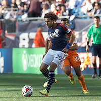 New England Revolution defender Kevin Alston (30) crosses the ball. In a Major League Soccer (MLS) match, the New England Revolution (blue/white) defeated Houston Dynamo (orange), 2-0, at Gillette Stadium on April 12, 2014.