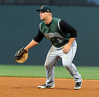 First baseman Ben Thomas (25) of the Augusta GreenJackets, a San Francisco Giants affiliate, in a game against the Greenville Drive on April 19, 2012, at Fluor Field at the West End in Greenville, South Carolina. (Tom Priddy/Four Seam Images)