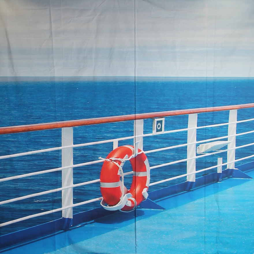 Backdrop featuring a ship's deck railing and nautical water view with life preserver for cruise ship boat