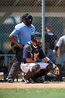 GCL Tigers East catcher David Noworyta (39) gives the signs in front of home plate umpire Mickey Smith during a game against the GCL Tigers West on August 8, 2018 at Tigertown in Lakeland, Florida.  GCL Tigers East defeated GCL Tigers West 3-1.  (Mike Janes/Four Seam Images)