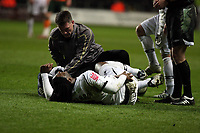 ATTENTION SPORTS PICTURE DESK<br /> Pictured: Jason Scotland of Swansea in agony on the ground is assessed by team physio Richard Evans after a hard tackle by a Plymouth player<br /> Re: Coca Cola Championship, Swansea City FC v Plymouth Argyle at the Liberty Stadium, Swansea, south Wales. 10 March 2009.<br /> Picture by D Legakis Photography / Athena Picture Agency, Swansea 07815441513
