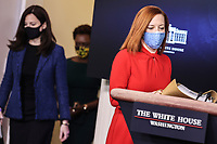 White House Press Secretary Jen Psaki, right, joined by White House deputy national security adviser Anne Neuberger, left, and White House principal deputy press secretary Karine Jean-Pierre arrives for a press briefing in the Brady Press Briefing Room of the White House on Wednesday, February 17, 2021, in Washington, DC. <br /> CAP/MPI/RS<br /> ©RS/MPI/Capital Pictures