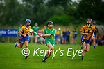 Kerry's Rachel McCarthy races past Clares Emma Kennedy    in the Munster Junior Camogie final