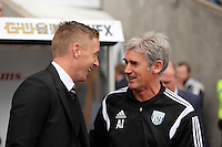 Pictured L-R: Swansea manager Garry Monk with West Bromwich Albion manager Alan Irvine. Saturday 30 August 2014<br /> Re: Premier League, Swansea City FC v West Bromwich Albion at the Liberty Stadium, south Wales, UK