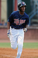 Elizabethton Twins shortstop Niko Goodrum #15 runs to first as he watches the ball clear the fence during a game against the Greenville Astros at Joe O'Brien Field on August 21, 2012 in Elizabethton, Tennessee. The Twins  defeated the Astros 7-5 (Tony Farlow/Four Seam Images).