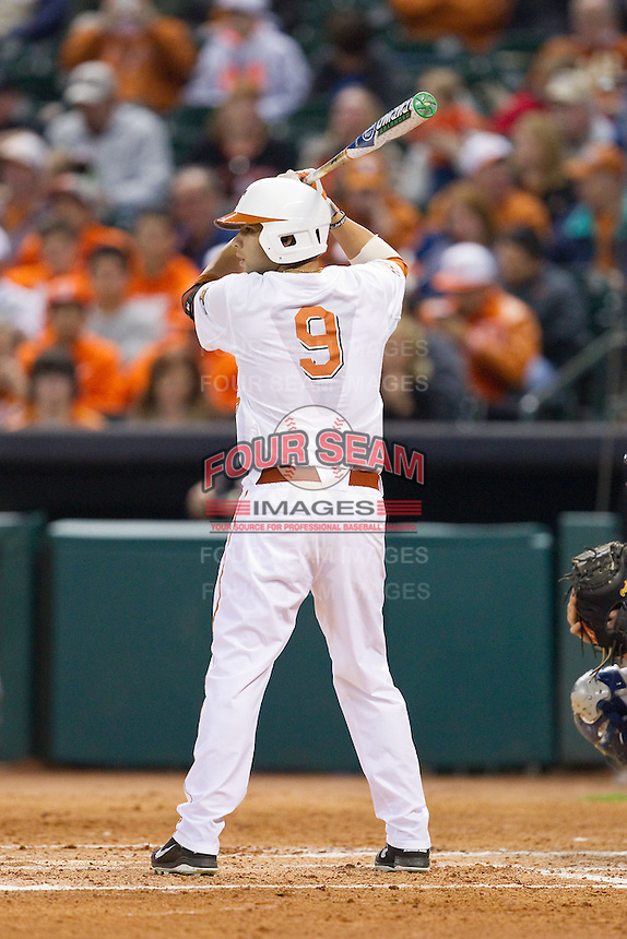 CJ Hinojosa #9 of the Texas Longhorns at bat against the Rice Owls at Minute Maid Park on February 28, 2014 in Houston, Texas.  The Longhorns defeated the Owls 2-0.  (Brian Westerholt/Four Seam Images)