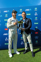 NZ captain Kane Williamson is presented with the series trophy by former NZ captain Brendon McCullum during day four of the second International Test Cricket match between the New Zealand Black Caps and Pakistan at Hagley Oval in Christchurch, New Zealand on Wednesday, 6 January 2021. Photo: Dave Lintott / lintottphoto.co.nz
