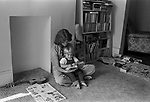 Mother reading to baby son. 1970s UK  70s  1975. London UK