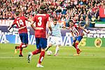 Atletico de Madrid's Gabi and Filipe Luis and Celta de Vigo's Nolito during La Liga Match at Vicente Calderon Stadium in Madrid. May 14, 2016. (ALTERPHOTOS/BorjaB.Hojas)