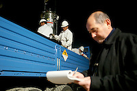 American-Ukrainian physicist Igor Bolshinsky monitors the loading of casks containing highly enriched uranium (HEU) from trucks onto an armoured train in Almaty. The removal of Kazakhstan's HEU is part of the U.S. Global Threat Reduction Initiative (GTRI), where Bolshinsky works, which tries to secure nuclear material around the world to prevent their misuse.