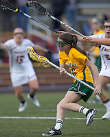 University of Vermont attacker Allison Pfohl (8) drives for the net. Boston College defeated University of Vermont, 15-9, at Newton Campus Field, April 4, 2012.