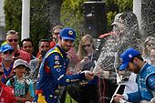 Alexander Rossi, Andretti Autosport Honda, Ed Jones, Chip Ganassi Racing Honda, Will Power, Team Penske Chevrolet celebrates with champagne in victory lane on the podium