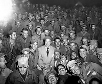 Bob Hope, radio and screen star, sits with men of X Corps, as members of his troupe enterain at Womsan, Korea.  October 26, 1950.  Cpl. Alex Klein.  (Army)<br /> NARA FILE #  111-SC-351586<br /> WAR & CONFLICT BOOK #:  1469