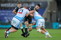 24th April 2021; Liberty Stadium, Swansea, Glamorgan, Wales; Rainbow Cup Rugby, Ospreys versus Cardiff Blues; Rhys Davies of Ospreys is tackled by Rhys Carre and Olly Robinson of Cardiff Blues