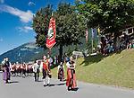 Austria, Vorarlberg, Montafon, Gaschurn: resort at Montafon region, national costume groups and bands marching through the village | Oesterreich, Vorarlberg, Montafon, Gaschurn: Prozession verschiedener Trachtengruppen und Spielmannszuege durch den  Urlaubssort im Montafon
