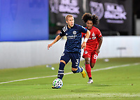LAKE BUENA VISTA, FL - JULY 26: Anton Tinnerholm of New York City FC dribbles away from Jayden Nelson of Toronto FC during a game between New York City FC and Toronto FC at ESPN Wide World of Sports on July 26, 2020 in Lake Buena Vista, Florida.