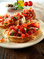 Fresh chopped beefsteak tomato bruschettas