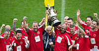 Winning celebrations as Calum Best & Luther Blissett lift the trophy during the Sellebrity Soccer - Celebrity & legends football match with profits going to Watford Community sports & education trust at Vicarage Road, Watford, England on 12 May 2018. Photo by Andy Rowland.