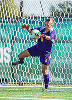 29 September 2013: University of Vermont Catamount Goalkeeper Morgan Nichols, a Senior from Concord, CA, makes a save against the Stony Brook University Seawolves at Virtue Field in Burlington, Vermont. The Lady Cats fell to the visiting Seawolves 2-1 in America East play. Mandatory Credit: Ed Wolfstein Photo *** RAW (NEF) Image File Available ***