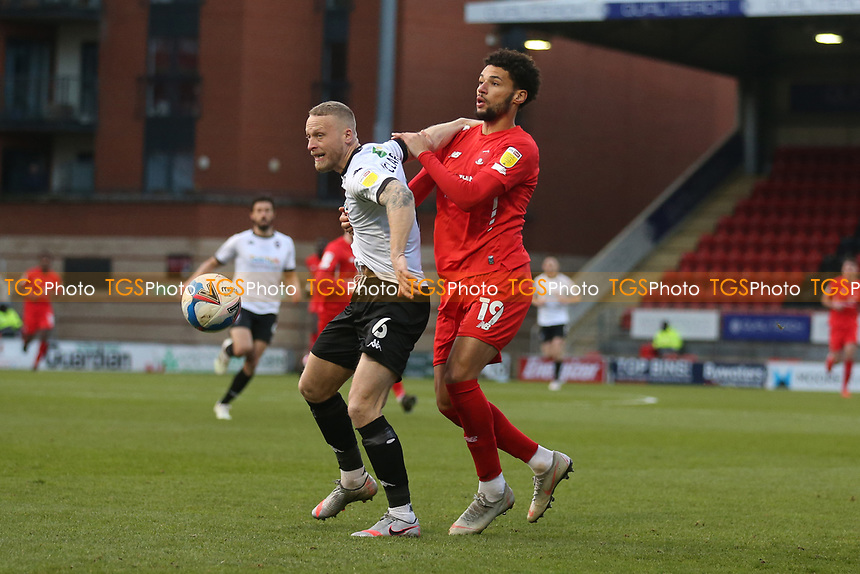 Tom Clarke of Salford City and Lee Angol of Leyton Orient during Leyton Orient vs Salford City, Sky Bet EFL League 2 Football at The Breyer Group Stadium on 2nd January 2021