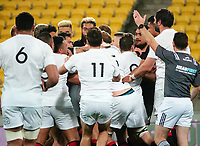 An impromptu group hug breaks out during the rugby match between North and South at Sky Stadium in Wellington, New Zealand on Saturday, 5 September 2020. Photo: Dave Lintott / lintottphoto.co.nz