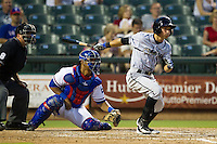 Omaha Storm Chasers outfielder David Lough #3 follows through on his swing during the Pacific Coast League baseball game against the Round Rock Express on July 22, 2012 at the Dell Diamond in Round Rock, Texas. The Express defeated the Chasers 8-7 in 11 innings. (Andrew Woolley/Four Seam Images).