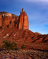 If you have ever had the chance to drive the Scenic Highway 24 in Utah, you will encounter a wonderful assortment of majestic landscapes and individual formations.  Chimney Rock, in Capitol Reef National Park, is an iconic formation that stands over 300 feet above the highway.  One can get a true appreciation of this geologic composition as sunset approaches.