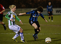 20131213 - VARSENARE , BELGIUM :  Brugge's Ingrid De Rycke (right) pictured with Zwolle's Mariska Kogelman (left) during the female soccer match between Club Brugge Vrouwen and PEC Zwolle Ladies , of  matchday 14  in the BENELEAGUE competition. Friday 13th December 2013. PHOTO DAVID CATRY
